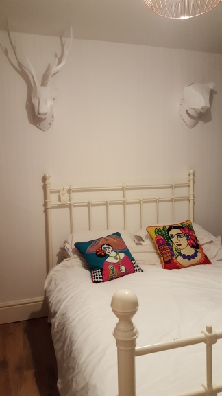 Appliqued Character Cushion from Graham and Greene , old Ikea bed frame, Pop Out Animal Heads