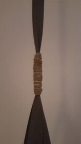 Step 6 - wrap some string or metal around to hid the really dodgy join between the cross and the length of ribbon